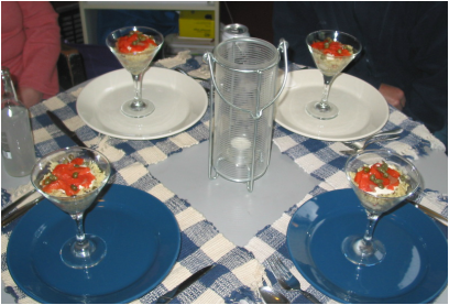 Table set with 4 martini glasses filled with the rice and smoked salmon recipe
