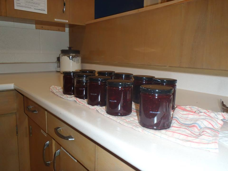 jars of homemade cranberry chutney cooling